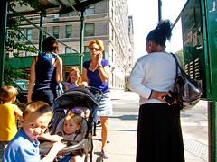 Everything's Under Control (UrbanphotoZ) Tags: nyc newyorkcity ny newyork children stroller manhattan mother cellphone sidewalk pedestrians upperwestside glance centralparkwest