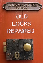 Sign outside old-fashioned ironmonger's shop, Ludlow (wonky knee) Tags: uk shropshire ludlow serrure doorlock ironmongers quincaillerie rickardsson lockrepair