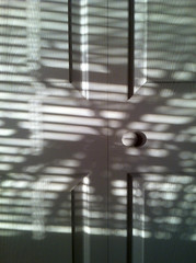 shadows (Mark.Swanson) Tags: door shadow closet doorknob iphone vision:text=0699 vision:outdoor=0599 vision:sky=0583 vision:car=0586