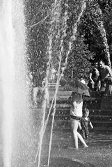 image (amarcord189) Tags: street city nyc summer people urban bw water fountain umbrella child angle candid freedom2012award