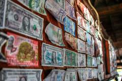 money, money, money.... (Baja Juan) Tags: vacation money bar hole cruising honduras local baja foreign roatan currency dollars watering