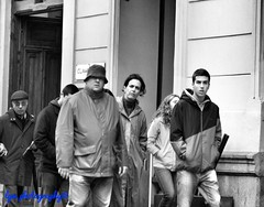 Foul Weather, Foul Mood? (Halcon122) Tags: madrid street bw del spain candid strangers streetphotography gear paseo looks prado badweather foul