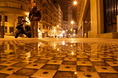 pinball (maybemaq) Tags: road street longexposure houses vacation house holiday man reflection portugal yellow night walking puddle gold mirror calle lowlight europa europe strada december camino geome