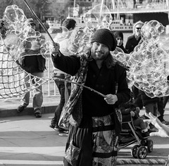 The Bubble Master (Strangers of London) Tags: life street city uk england people blackandwhite bw man guy london love photography photo moments candid picture citylife bubbles dude southbank bnw streetshot candidshot londonlife candidphoto streetphotographer londonstreetlife vision:outdoor=0949