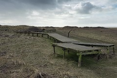 Boardwalk to Nowhere (the underlord) Tags: wood winter beach sand timber dunes coastal walkway boardwalk bleak southport foreshore displaced forsure xf1 fujixf1