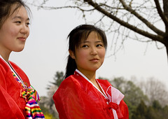 DEUX AMIES DANS UN PARC DE PYONGYANG, COREE DU NORD (Eric Lafforgue Photography) Tags: voyage travel portrait woman color colour girl smile face horizontal asia dress robe feminine femme hanbok asie custom 2008 fille sourire couleur northkorea visage ideology axisofevil pyongyang eastasia feminin dprk traditionalclothing juche coleur northkorean dictature democraticpeoplesrepublicofkorea northkoreans koreanpeninsula juchesocialistrepublic coreedunord rdpc koreanethnicity insidenorthkorea joseonot