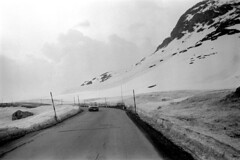 04a3471 15 (ndpa / s. lundeen, archivist) Tags: nick dewolf nickdewolf bw blackwhite photographbynickdewolf film monochrome blackandwhite april 1971 1970s 35mm europe centraleurope switzerland swiss alpine alps graubünden grisons easternswitzerland suisse schweitz mountains peaks snow snowy snowcovered landscape swissalps road highway ontheroad roadtrip car vehicle automobile