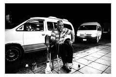A man smokes shisha outside in Aqaba, Jordan (Roman Lunin) Tags: aqaba jordan man smoking street streetphotography blackandwhite blackwhite streetblackwhite monochrome outside shisha arab cafe candid sneaky