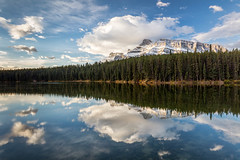 Fluffy Clouds (Kirk Lougheed) Tags: alberta banff banffnationalpark canada canadian canadianrockies johnsonlake mountrundle mtrundle rundle autumn cloud fall forest lake landscape morning mountain nationalpark outdoor reflection sky water