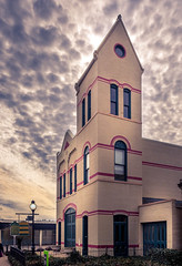 Holland City Hall and Firehouse #2 (Geoff Eccles) Tags: firehouse2 jameshuntley usa creambrick redbrick creambuilding creamandredbrick oldcityhall clouds holland yellowsky cityhall sunspots greatlight firehouse mackrellsky sunlight historicdistrict oldfirehouse light michigan