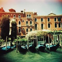 Gondolas - lomo (sonofwalrus) Tags: xpro xprocessed holga film lomo lomography scan venice italy italia europe venezia canal water boats buildings architecture gondolas