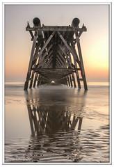 Almost reflection (Lynne J Photography) Tags: pier sunrise pastel long exposure beach rapeseed dusk sunset chemicalbeach seaham wheels sand steetley dawn colors rocks sidelight