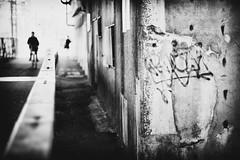 The wall (tomorca) Tags: graffiti wall bokeh bicycle people silhouette monochrome bw street fujifilm xt2 nokton voigtlander