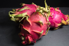 Three Dragon Fruits on a Cutting Board (Transient Eternal) Tags: food hylocereus stenocereus crunchy dessert dinner dragonfruit eat fruit fuschia good healthyfood juicy meal nutrient nutritious pink pitahaya pitaya seeds superfood sweet whiteth