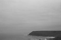Phillip Island (pablo.sutton) Tags: hillvale nikonfm2n kodak trix 400iso 50mmf18 cliff dawn bw noiretblanc blackandwhite film analogue filmneverdie atmospheric sea sky cloud oppressive