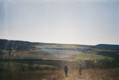 Descending (Moesko Photography) Tags: analogue smena8m hill mountain trees field landscape people lábatlan sky afternoon spring hungary woman man nature