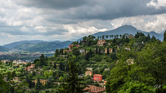 Hills of Bergamo, Lombardy, Italy (podrozuje) Tags: bergamo lombardy italy hill green skyclouds building house forest grass panoramic view mountains horizon outdoors explore travel europe milan tree roof red blue gray white light ambient trip visit sightseeing