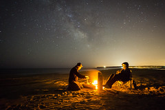 Campfire under Milkyway. Shoreline. Languedoc Roussillon, France. (BadGunman) Tags: nuit ciel europe plage feu 16mm28 a6000 nikon canon sony singleshot longexposure aude france languedocroussillon sand brother people sky stars ocean sea shoreline camping beach voielactee milkyway fire campfire