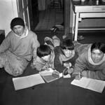 Inuit children studying in the kitchen of Reverand W. J. R. James of St. Aidan's Anglican Mission... / Des enfants inuits étudiant dans la cuisine du révérend W. J. R. James de la mission anglicane de St. Aidan... thumbnail