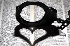 Cliché (lenswrangler) Tags: lenswrangler digikam book heart cliché macromondays crime handcuff peerless insidejoke dictionary chain