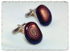 Swirl pattern cufflinks in pearlised blue and pink.