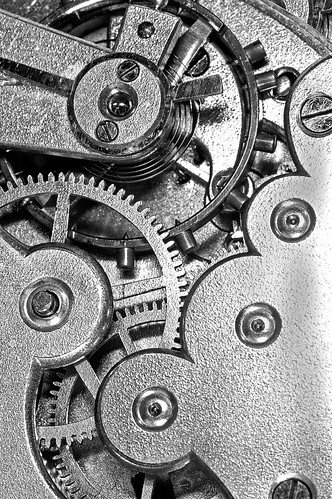 gears and mainspring in the mechanism of a clock