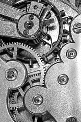 gears and mainspring in the mechanism of a clock (Francis Jimnez Meca) Tags: old clock face closeup vintage spring slow wind time antique interior teeth watch fast dial retro timepiece repair hour works second inside tick pocket clockwork wound gears mechanism adjustment jewel accurate pocketwatch minute bearing adjust accuracy horology escapement regulate mainspring horologist