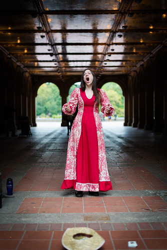 An opera singer performs at the Bethesda Arcade in Central Park in New York