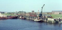 Once upon a time - The Netherlands - Hellevoetsluis (railasia) Tags: holland ferry crane quay depot interurban hellevoetsluis infra sixties rtm photographyby 1067mm rollingstockaside lostsystem