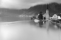 Hallstatt (Black & White) (baddoguy) Tags: city longexposure bw mountain lake church water horizontal ferry architecture austria blackwhite village scenic tranquility nopeople landmark picturesque iconic worldheritage hallstatt traveldestination