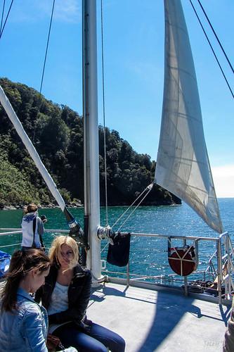 sea newzealand sky people mountains water clouds boat ship scene cliffs nz sail southisland fjord milfordsound tasmansea lanscape mitrepeak fiordlandnationalpark southwestnewzealandworldheritagearea milfordmarner milfordsoundnaturecruise