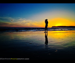 Silhouette of a Photographer – Coronado Beach, San Diego, California (Sam Antonio Photography) Tags: ocean california travel blue sunset sea sky people panorama usa cloud seascape west reflection love tourism beach nature public water silhouette horizontal skyline del walking landscape outside outdoors island person photography star hotel coast seaside glamour sand photographer pacific sandiego horizon over fulllength shoreline victorian scenic scene pacificocean coastal shore barefoot historical coastline coronado vacations luxury onthemove wealth hoteldelcoronado iphone tranquilscene fashioned californiabeach casualclothing californialandscape coronadobeach traveldestinations unrecognizable sandiegosunset sandiegobeach thebestcamera appleiphone iphonephotography chasejarvis californiatravel