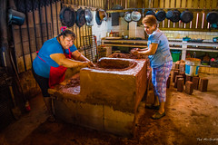 Barra de Potosi Mexico - Nov 13 - Building a new Clay 3-burner Cooktop (3 of 5) (Ted's photos - For me & you) Tags: travel blue ladies red portrait brick kitchen pose mexico bucket sandals working apron pots clay stove earrings range countertop enramada pail cooktop pans potspans wonderfulworld redapron lacondesa 5photosaday fashioning tedsphotos enramadalacondesa