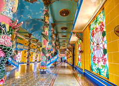Colorful Interior of Cao Dai Temple (Rosita So Image) Tags: architecture temple worship colorful islam religion buddhism philosophy vietnam hinduism caodai taoism tayninh holysee catholism caodaism mothergoddess confusianism syncretistic greatdivinetemple rositasoimage geniism