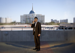 Governement Employee In Front Of Presidential Palace, Astana, Kazakhstan (Eric Lafforgue Photography) Tags: people man building male monument horizontal architecture standing asian outside outdoors person exterior power phone telephone president capital fulllength cellphone bluesky blurred palace structure cupola dome mobilephone centralasia kazakhstan kazakh humanbeing sights easterneurope gsm astana contemplation presidentialpalace tiltshift lookingatcamera officialbuilding akorda nursultannazarbayev governmentemployee lookingcamera akmola akmolinsk akordapresidentialpalace noursoultannazarbaiev kz5164