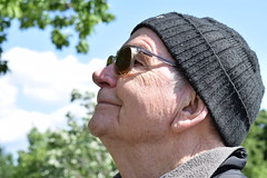 Dreaming (boostedstockphotos) Tags: people portrait philly philadelphia person individual inspire think create outdoors walk elderly senior citizen park sunshine older gentleman man beanie glasses thinking travel pondering envisioning advertisement baby boomer winter explore exploring