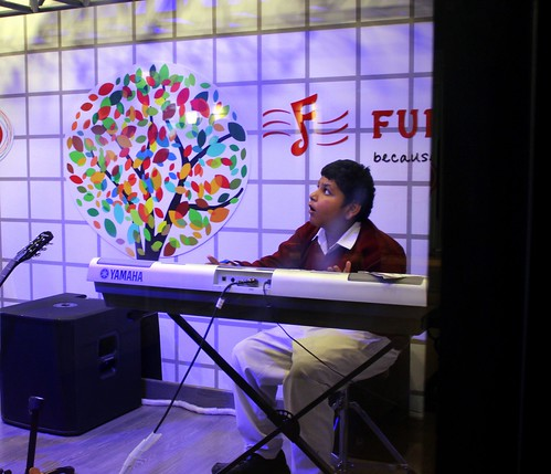 KidZania Tour for Kids with disabilities: A kid from the group enjoying the music class!