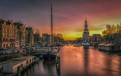 Amsterdam Sunset (mcalma68) Tags: amsterdam architecture authentic canals canal montelbaantoren oude schans prins hendrikkade sunset dutchlandscape cityscape urban boat tower clock