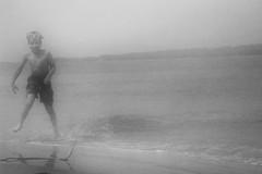 Early Morning Swim (EXPLORED) (mfhiatt) Tags: p10100190417jpg beach surf swim fog mist explore explored blackandwhite