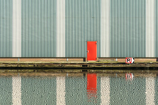 Reflection of a red door