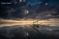 Anchored on a Mirror ! (segokavi) Tags: boat bali sunrise sanur reflection landscape seascape water sea nature