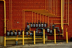15 meters ([dscphoto]) Tags: pipes wall yellow industrial gas meters gasmeters toronto