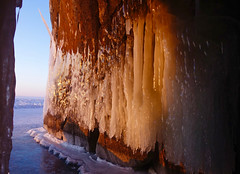 Golden Ice Curtains (setoboonhong ( Back & catching up )) Tags: travel lake baikal southern siberia russia caves icicles ice reflections golden hour sunlight sunrise patterns icesheets rocks lichen song gold spandau ballet 1983 landscape cold frozen