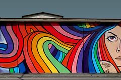 decoro urbano (Rino Alessandrini) Tags: muro graffito murales colori disegno gradazioni tetto linee curve triangolo murodicinta murals wall drawing color gradations roof curved lines triangle streetart