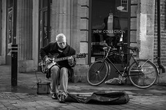 Marvin B Naylor (Silver Machine) Tags: winchester hampshire streetphotography street streetportrait busker busking guitar guitarist epiphone bigsby roland folk acoustic sitting rock people outdoor blackwhite bw mono monochrome fujifilm fujifilmxt10 fujinonxf35mmf2rwr