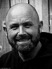 The Builder (2) (Neil. Moralee) Tags: hemyockdevonneilmoralee man builder portrait natural light daylight bald balding hair loss hairloss beard boy mature smile happy cheerful black white mono bandw bw blackandwhite people outdoor grin cheeky hemyock devon uk england root stuart village face close nikon neil moralee d7100 18300m