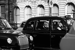 Stuck in the middle with you. (tanyalinskey) Tags: trafficjam london blackcabs taxis taxi monochrome blackwhite 7dwf
