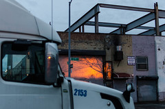 The Sun Saying Goodbye (Daniel C. Schneider) Tags: brooklyn shadow semi nikon industrial truck cloudy reflection d7000 warehouse sunsetpark clouds