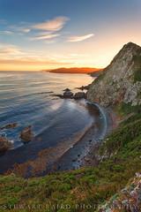 Last Light at Nugget Point (stewartbaird) Tags: shoreline landscape sunset water southisland sea beach newzealand clouds otago rocks sky seascape gold coast catlins nuggetpoint