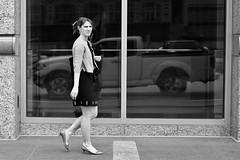 Short Sweater (burnt dirt) Tags: houston texas downtown city town mainstreet street sidewalk corner crosswalk streetphotography fujifilm xt1 bw blackandwhite girl woman people person phone cellphone purse bag standing walking sweater short ponytail heels stilettos